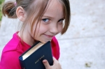 little-girl-with-bible-outside-church
